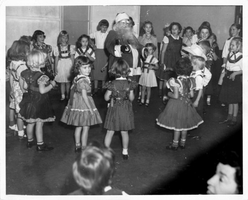 Miller performing for children as Santa Claus while pregnant with her daughter Louise in 1952.