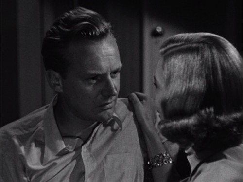 Alan (Arthur Kennedy) and Jane (Lizabeth Scott) argue about the money.