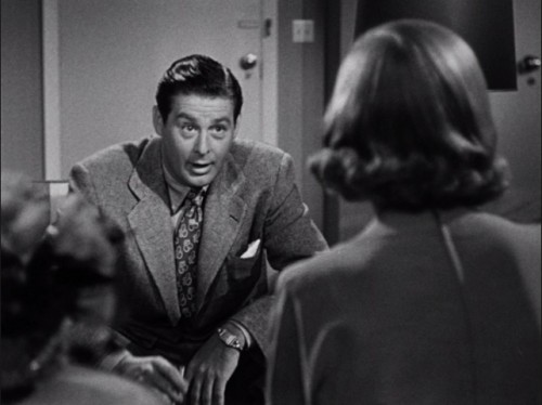 Don (Don DeFore) interrogates Jane (Lizabeth Scott)...