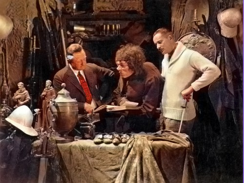 "On the set of The Hunchback of Notre Dame (1923). From left to right: Wallace Worsley (director), Lon Chaney (""Quasimodo""), and Norman Kerry (""Phoebus""). Photo colorized by Robert M. Fells."